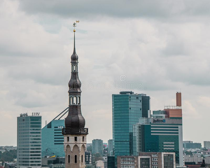 One of the symbols of Tallinn, weather vane Old Thomas on the background of modern buildings. It has been adorning the spire of royalty free stock photography