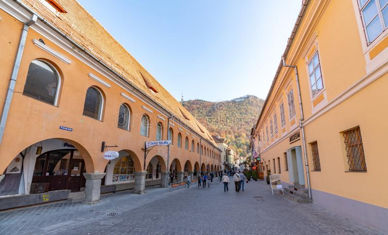 Shopping rows on the pedestrian street of old Brasov in Romania. One of the ten largest cities in Romania. Located in the heart of Romania, the city of Brasov is stock photos