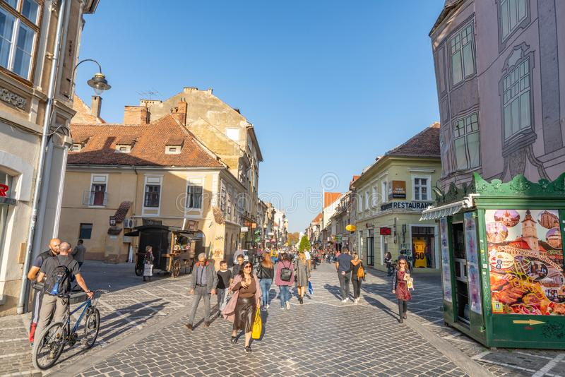 On the pedestrian street in old Brasov in Romania. One of the ten largest cities in Romania. Located in the heart of Romania, the city of Brasov is sometimes stock photography