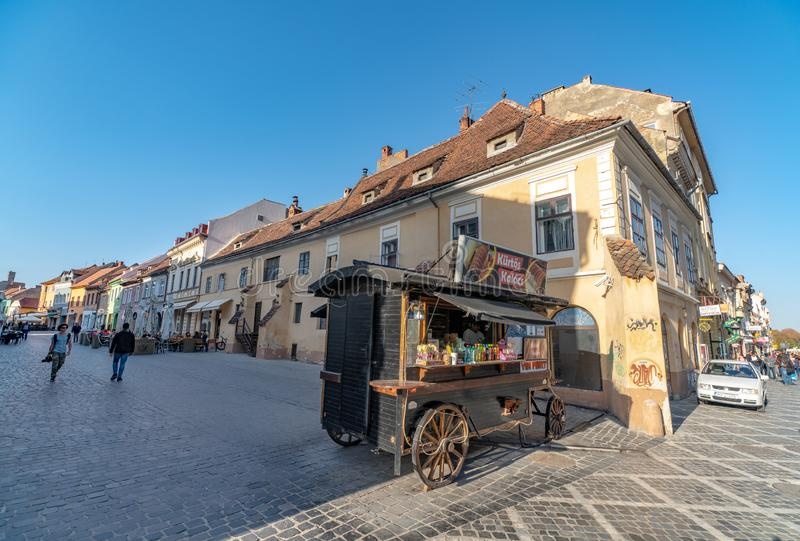 Mobile diner on the pedestrian street of Romanian Brasov. One of the ten largest cities in Romania. Located in the heart of Romania, the city of Brasov is royalty free stock images
