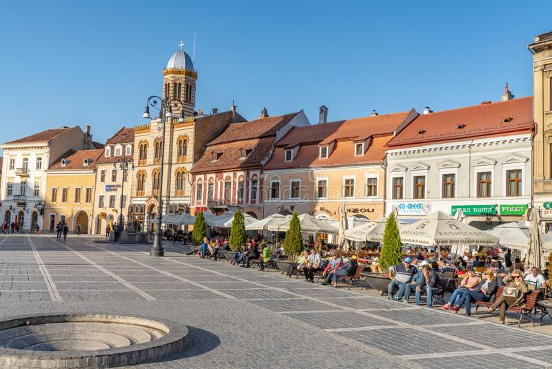 Vacationers on the central square of the old Brasov in Romania. One of the ten largest cities in Romania. Located in the heart of Romania, the city of Brasov is royalty free stock images