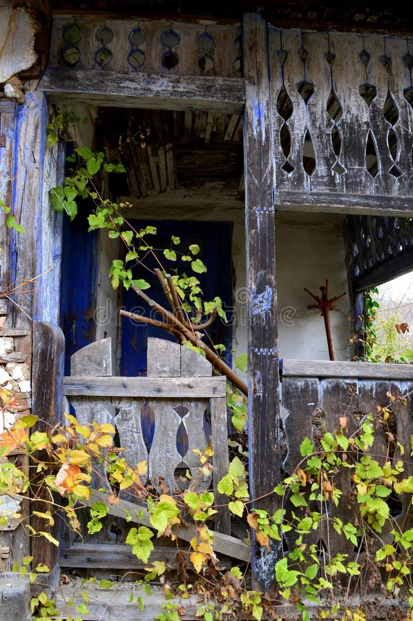 Terrace on old abandoned house. One terrace on old abandoned house stock photo