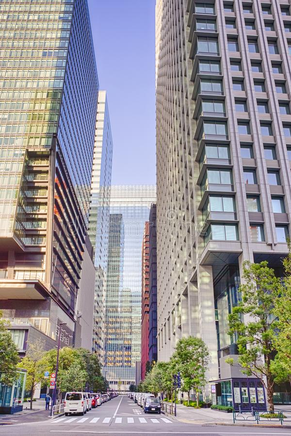 In One of Th Streets of Tokyo. Business Buildings and Skyscrapers in Tokyo At Daytime. Vertical Composition royalty free stock photos