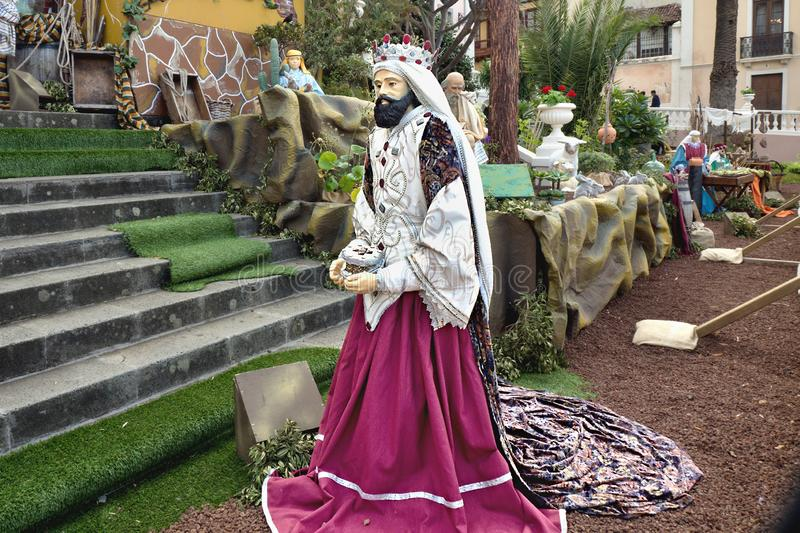 One of the three holy kings in the biblical Christmas story in life-size with magnificent velvet robe. Melchior, the king of Nubia and Arabia, wearing red royalty free stock photography