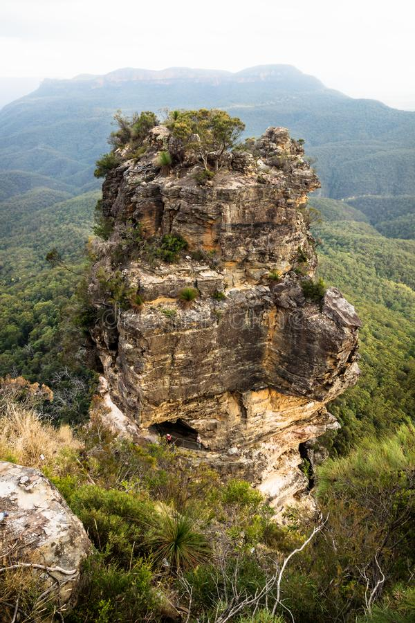 One of the Three sisters rock formation aerial view with mountain background, Katoomba, New South Wales, Australia stock photo