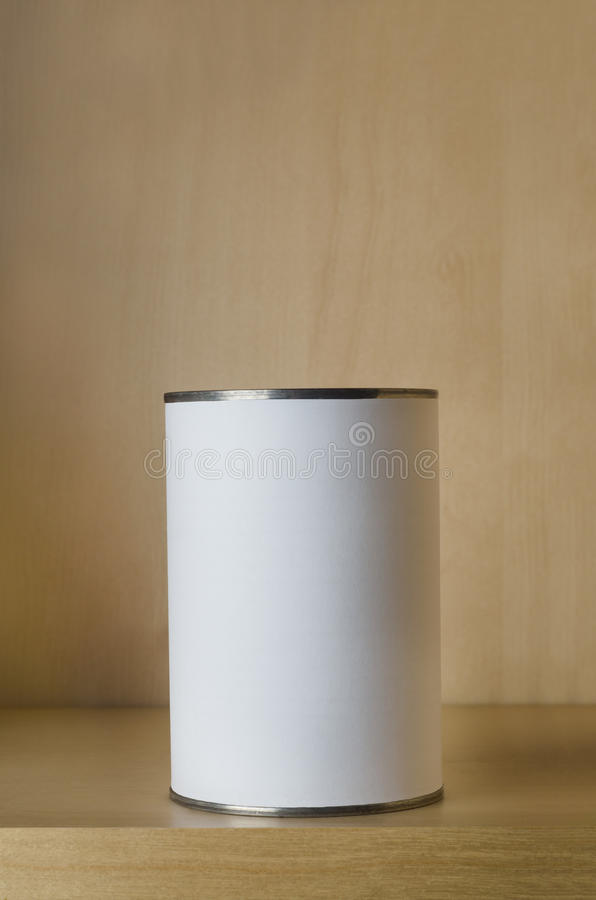One Tin with Blank Label on Shelf. One single tin can (aluminum) with blank white label on shelf with copy space above royalty free stock images