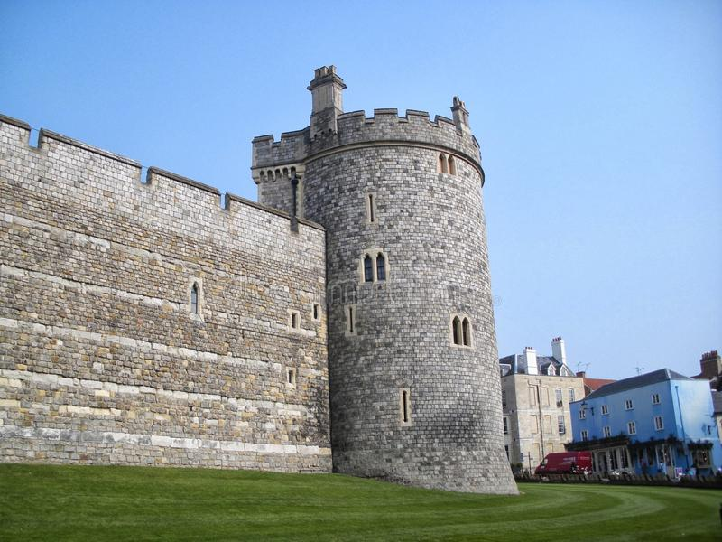 Exterior of Windsor Castle Tower in England UK. One of the towers of Windsor Castle with town in background, sky, grass stock photo
