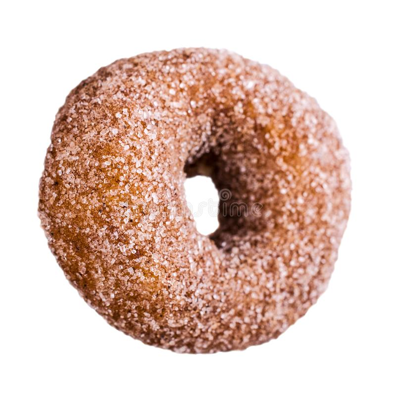 One traditional donut in sugar. On a white background. Selective focus royalty free stock image