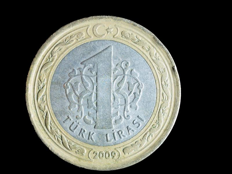 One turkish coin on black background stock images