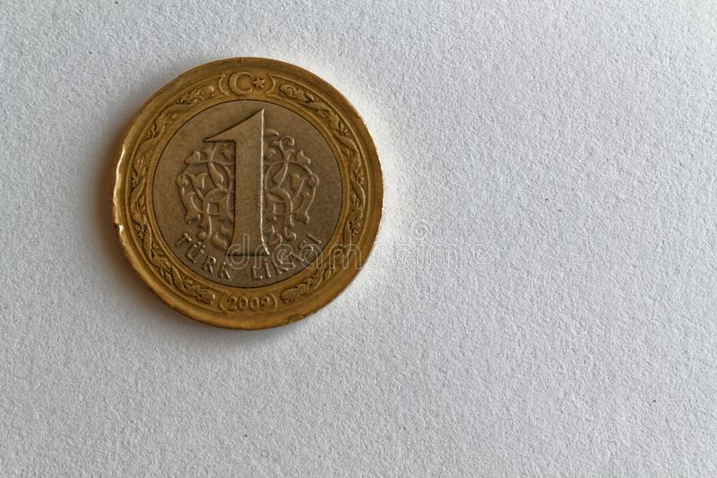 One Turkish coin denomination is 1 lira lie on isolated white background royalty free stock image