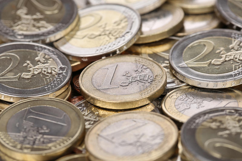 One and two Euro coins from Europe stock images