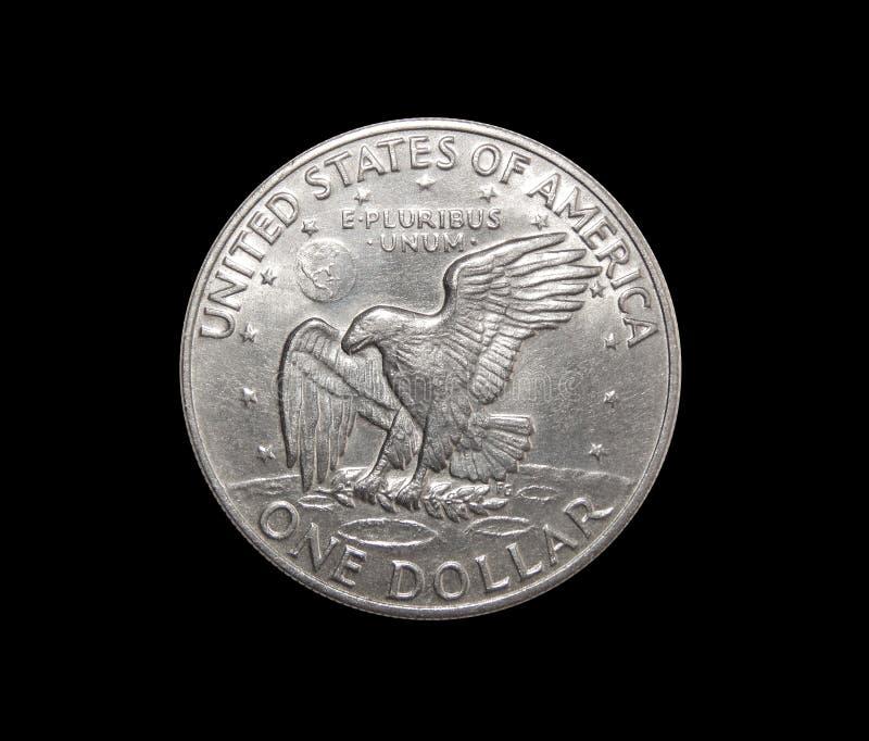 One US dollar coin on isolated black background. American dollar eisenhower lunar dollar on isolated black background stock images