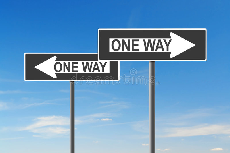 One way. Two One Way roadsigns indicating opposite directions over blue sky - confusion concept stock photos