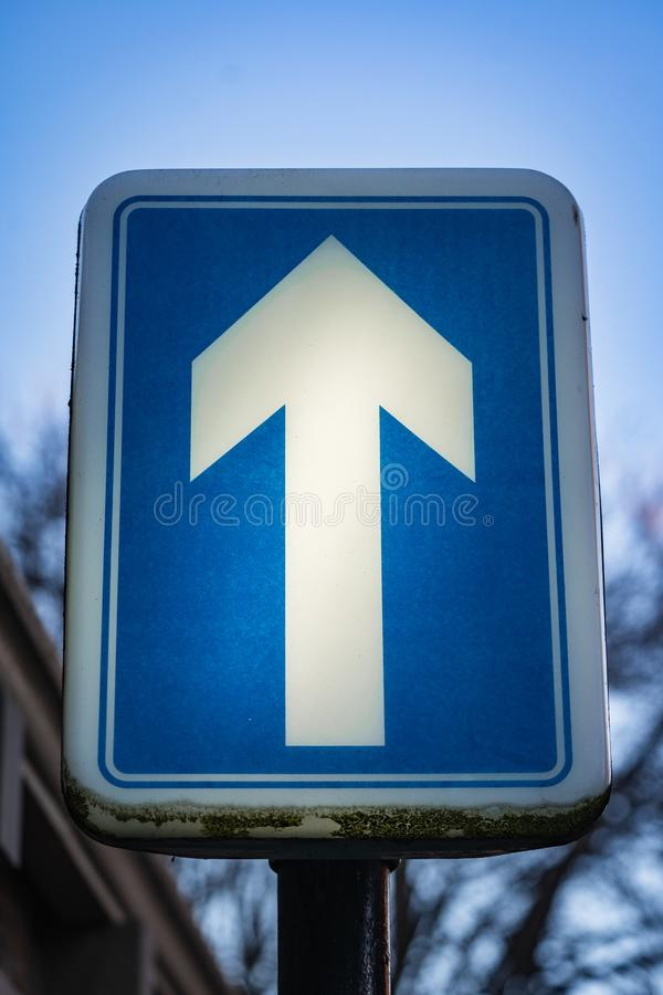 One Way Illuminated Road Sign. A close up of an illuminated One Way road sign stock image