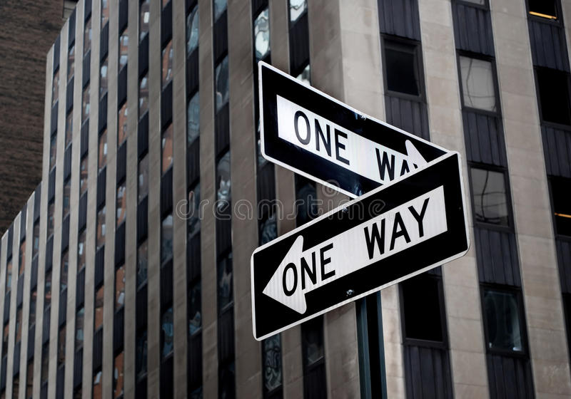 One way road sign stock photos