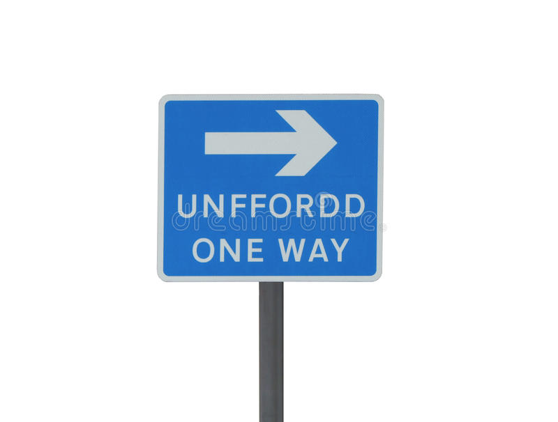 One way road sign in English and Welsh. Dual-language English and Welsh one way road sign, isolated against white background royalty free stock images