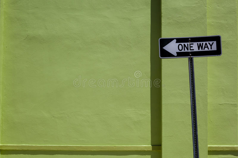 Download One Way Sign & Green Wall Royalty Free Stock Photography - Image: 25841087
