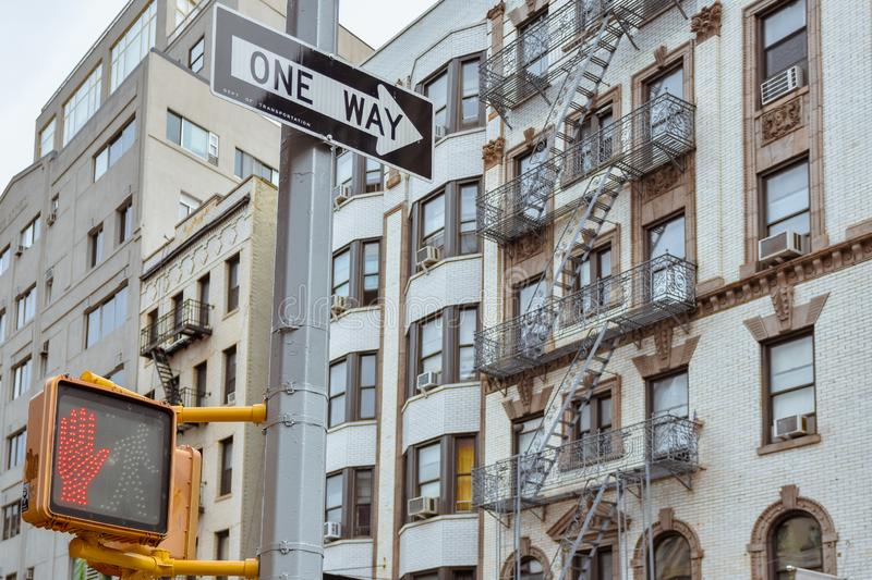 One way sign and old apartment facades, with fire stairs. Soho, Manhattan. NYC. USA royalty free stock photos