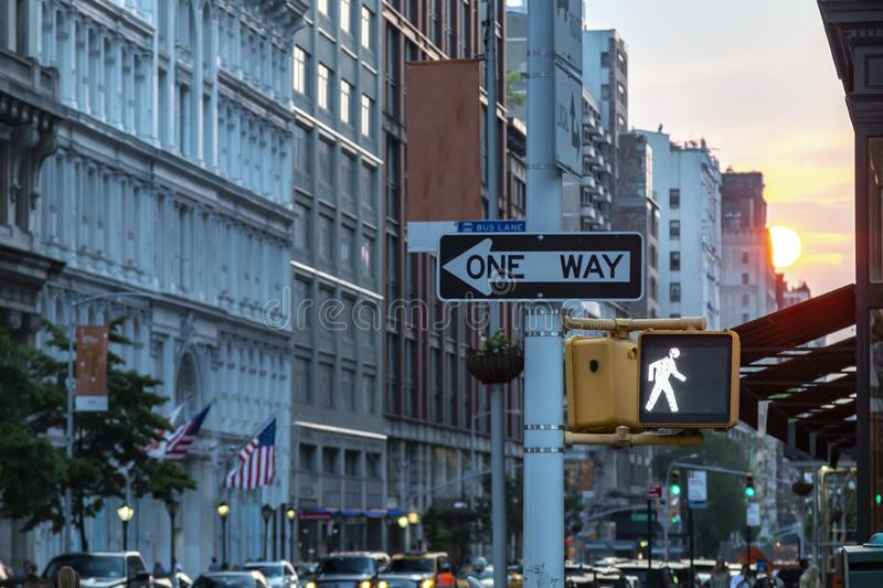 One way street sign on 5th Avenue in Midtown Manhattan New York City with the light of sunset in the background royalty free stock images