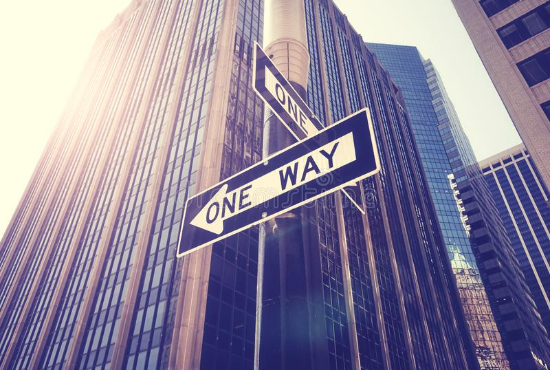 One way street signs against the sun in New York City, USA. One way street signs against the sun in New York City, color toning applied, USA stock photography