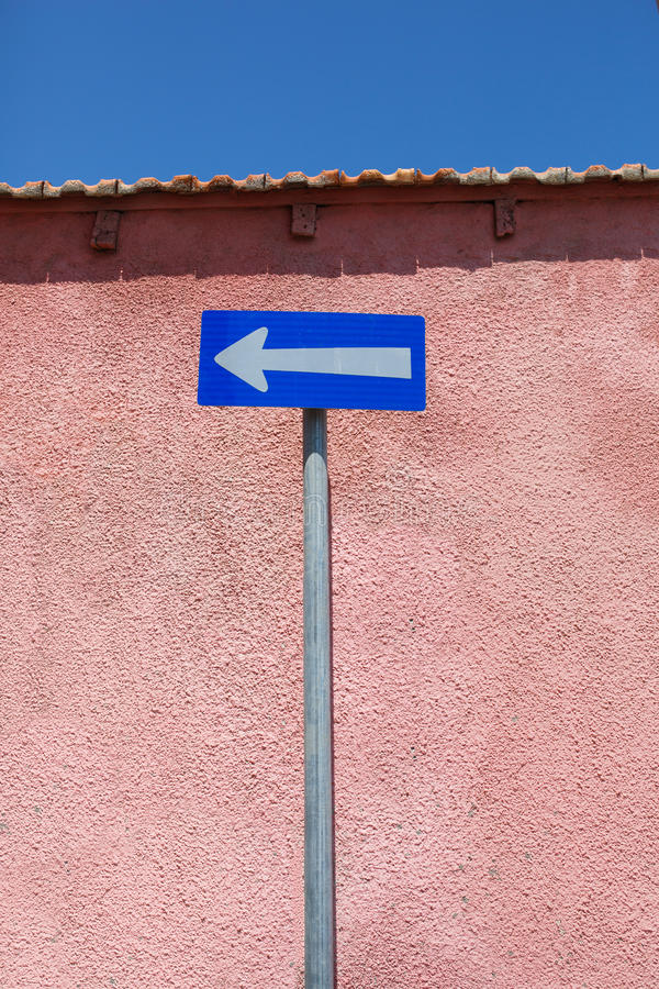 One-way traffic road sign. White arrow on blue background stock image