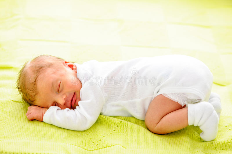 One week old newborn baby stock image