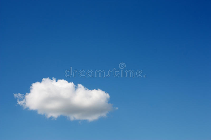 One white cloud in the blue sky stock photo