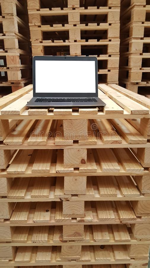 One white laptop monitor screen for warehouse staff on stacking wooden pallet, working condition, decoration stock images