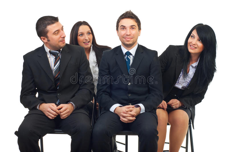 He is the one who did it. Four business people at seminar sitting on chair.One of the man did or said something and having an oops ! face and his colleagues royalty free stock photography