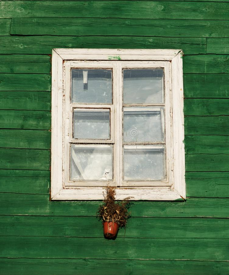 One window in vintage style in green wall background,architecture details. Colorful window fragment.Street scene with the house wi. Ndow. Vintage window stock image