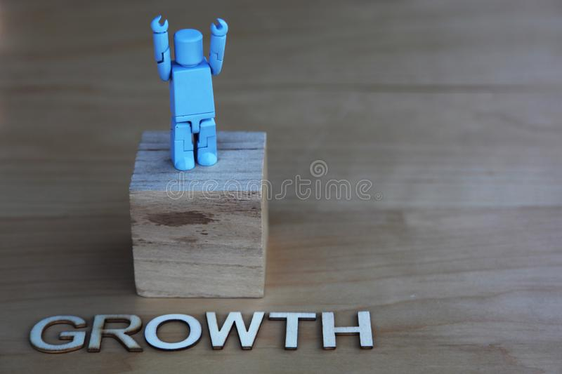 One winner with arms raised next to the word Growth stock photo