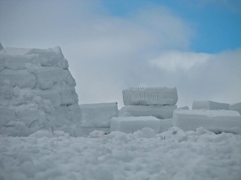 Building a igloo in a harsh climate royalty free stock images