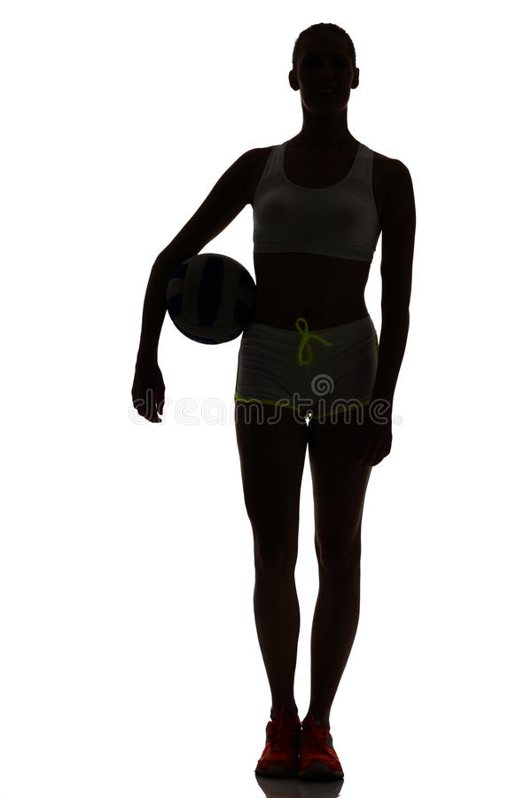 One woman beach volley ball player silhouette in studio silhouet stock image