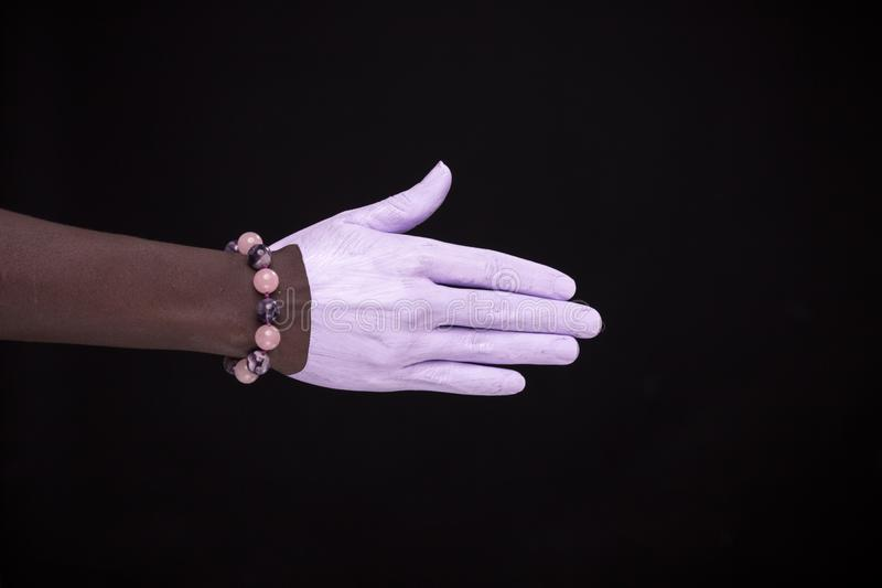 One woman hand, african american painted hand skin, black background, jewelery bracelet. One women hand, african american painted hand skin, black background stock photography