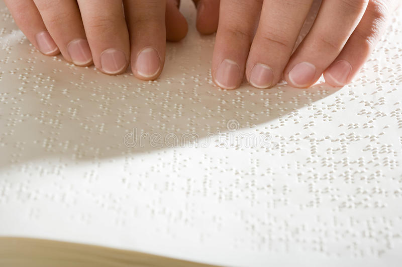 One woman reading braille. One women reading braille royalty free stock photography