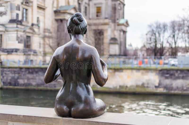 One woman from sculpture Bathers on the Spree. One woman from famous sculpture Bathers on the Spree in Berlin. It's located on Spreepromenade near Berliner Dom royalty free stock photography