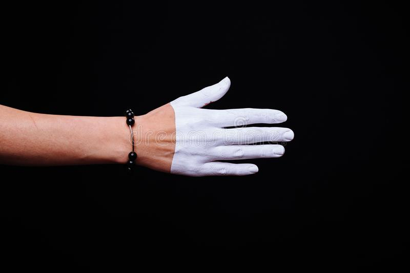 One woman hand, Caucasian painted hand skin, black background, j. One women hand, Caucasian painted hand skin, black background, jewelery bracelet stock photo