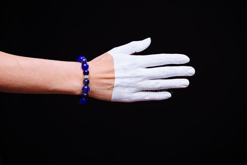 One woman hand, Caucasian painted hand skin, black background, j. One women hand, Caucasian painted hand skin, black background, jewelery bracelet stock photos