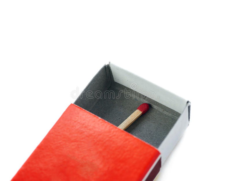 One Wooden match in box isolated over the white background stock images