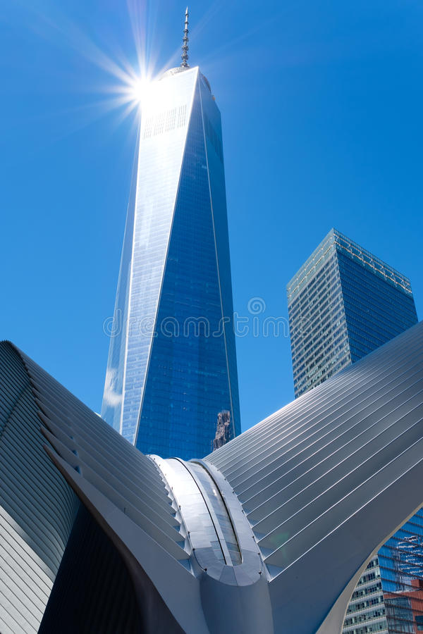 The One World Trade Center skyscraper in downton Manhattan. NEW YORK,USA - AUGUST 22,2016 : The One World Trade Center skyscraper in downton Manhattan reflecting royalty free stock images