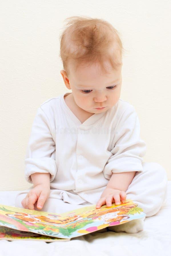 One year baby boy reads children s book