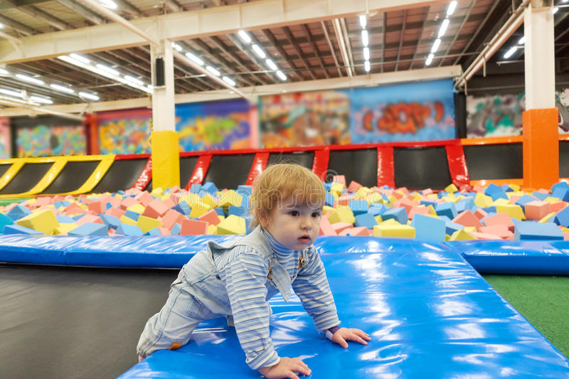 The One Year Old Baby Cute Playing In Indoors Playground. stock photography