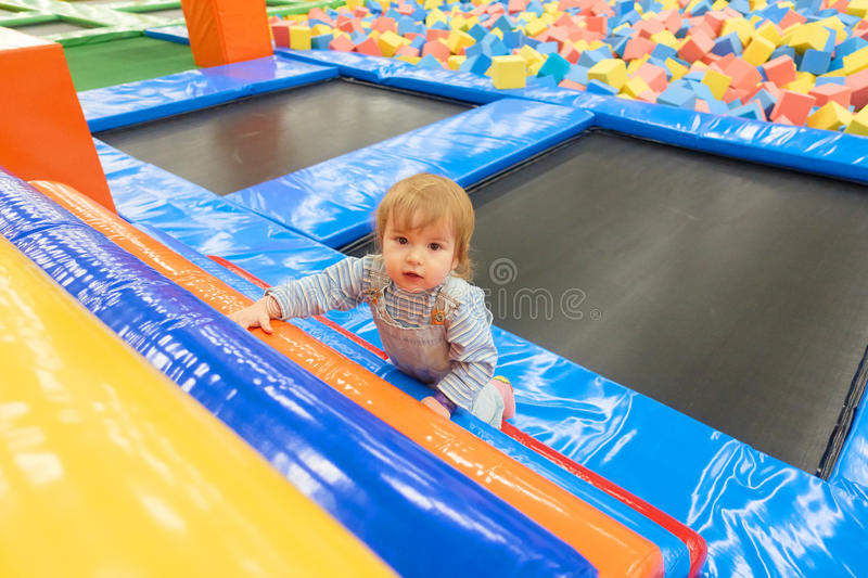 The One Year Old Baby Cute Playing In Indoors Playground. royalty free stock photo
