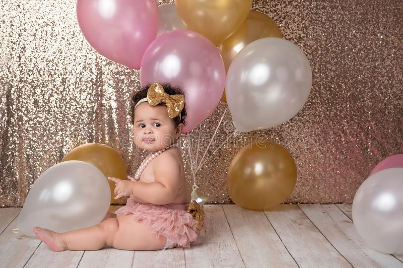 One Year Old Baby Girl with Balloons stock images