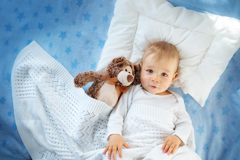 One year old baby with a teddy bear royalty free stock photo