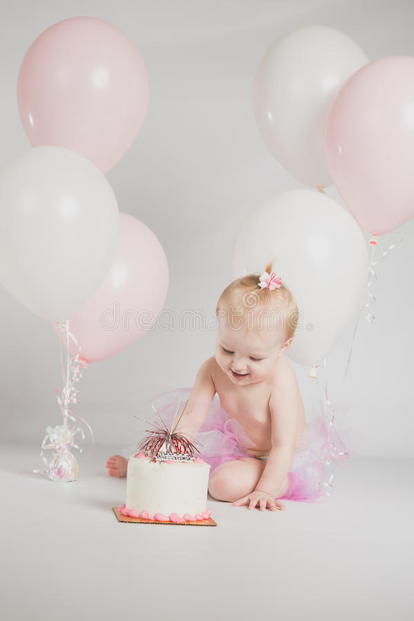 One Year Old Birthday Portraits With Smash Cake stock images