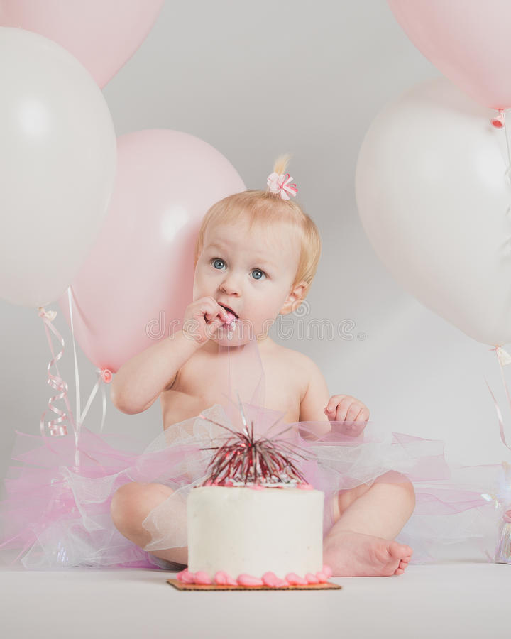 One Year Old Birthday Portraits With Smash Cake And Balloons Stock