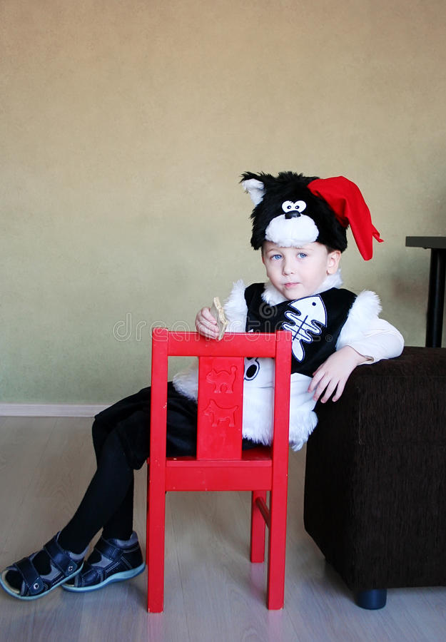 One funny child clothed in a fancy-dress of a tomcat in a room royalty free stock images