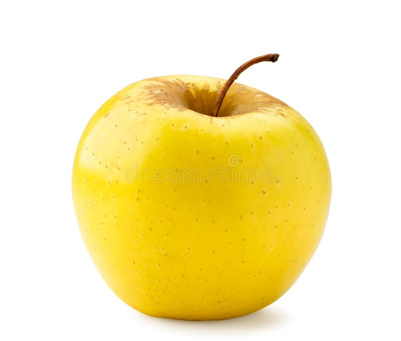 One yellow Apple close-up on a white. Isolated royalty free stock photo