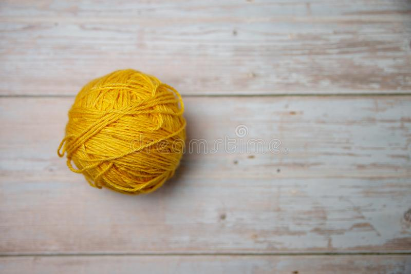 One yellow ball of thread stock photography
